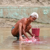 ganges-river-varanasi-india-man-washing-cloths