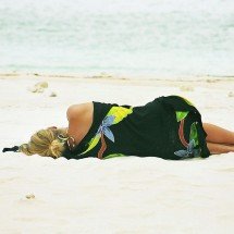 woman-sleeping-on-beach-indonesia