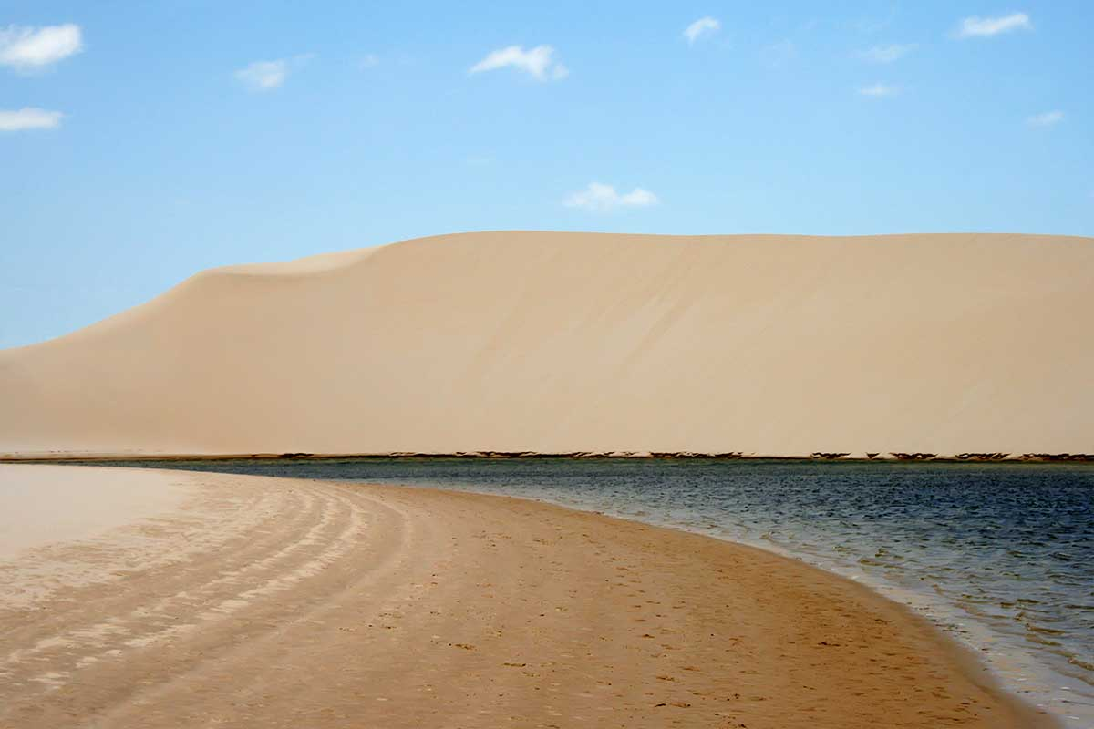 Composed of large, white, sweeping dunes, at first glance Lençóis Maranhenses looks like an archetypal desert, but in fact it is not an actual desert. Lying just outside the Amazon Basin, the region is subject to a regular rain season during the beginning of the year.