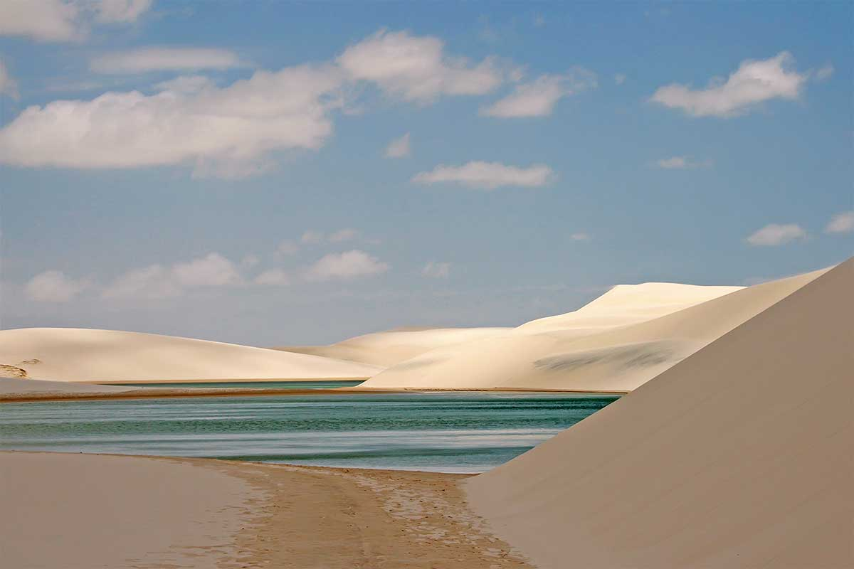 Lençóis Maranhenses National Park is an area of low, flat, occasionally flooded land, overlaid with large, discrete sand dunes. It encompasses roughly 1.500 km2, and despite abundant rain, supports almost no vegetation.