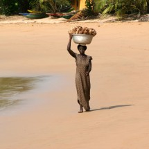 woman-walking-on-takoradi-beach-ghana