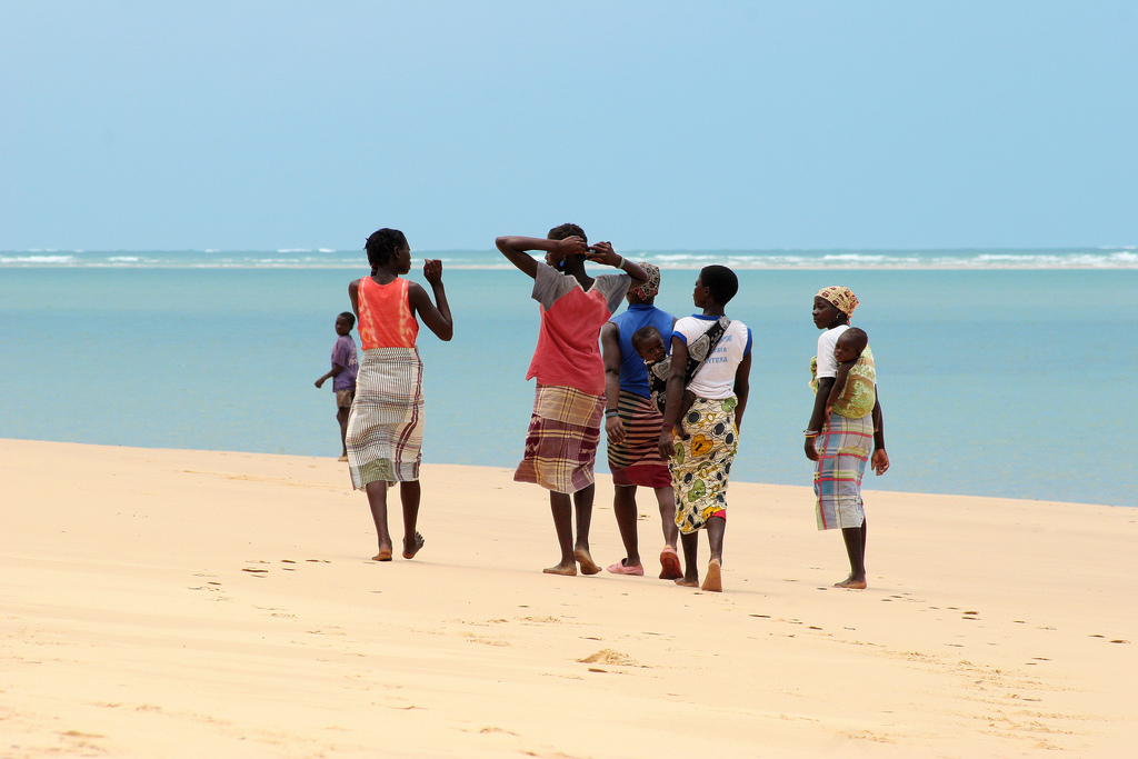 Ladies walking along Bazaruto Island in Mozambique.