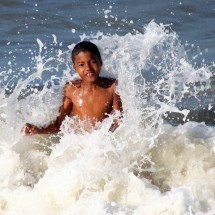 boy-playing-in-ocean-brazil