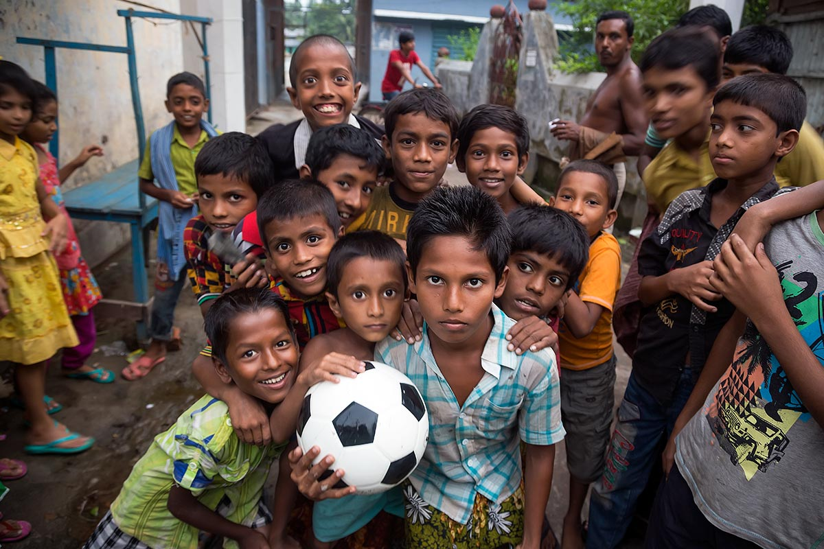 Kids playing football in the streets of Galachipa in Bangladesh.
