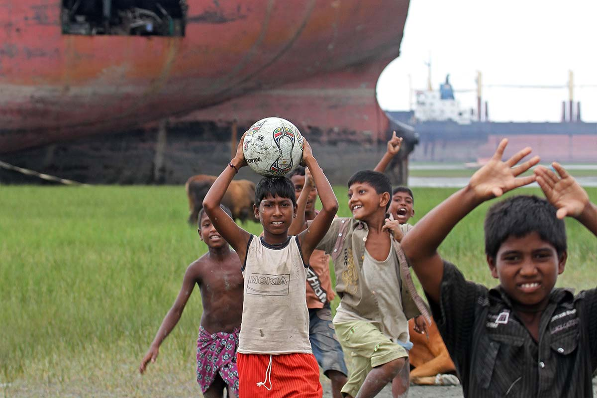 Kids playing football at the Ship Breaking Yard in Chittagong, Bangladesh.
