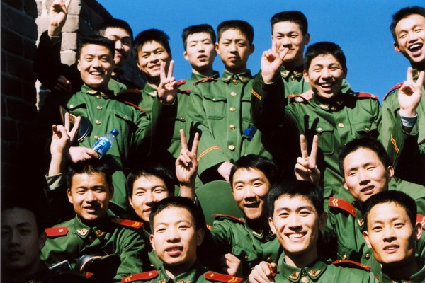 A bunch of happy officers at the Great Wall in China.