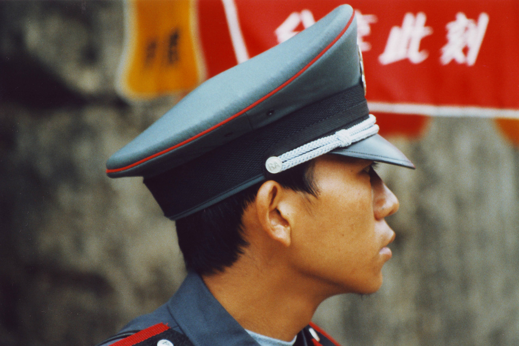 An officer in front of the Lost City in Beijing.