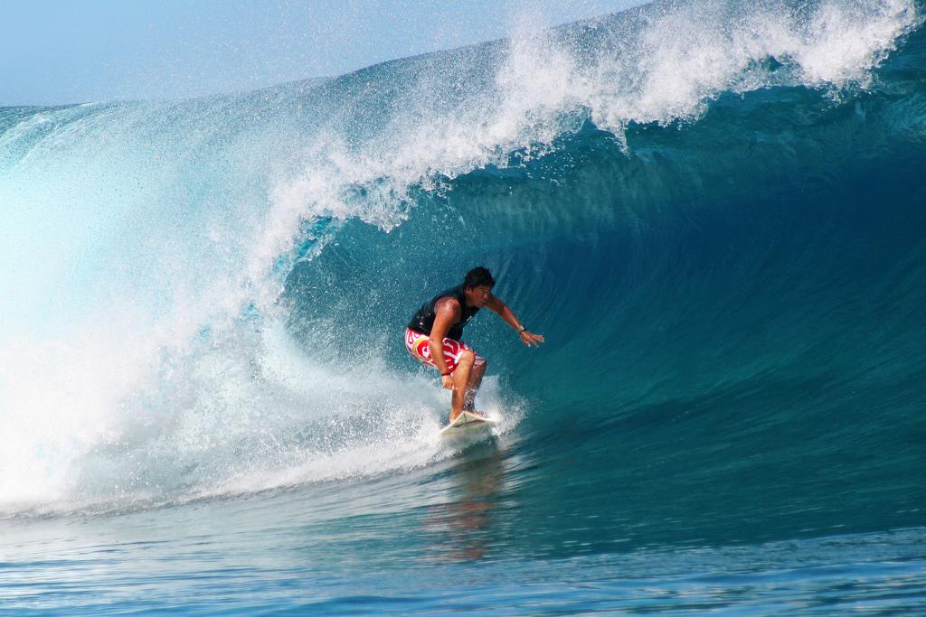 Pro-surfer Raimana Van Bastolaer surfing Teahupoo, Tahiti.