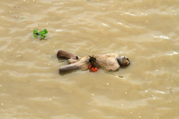 dead body floating in the Ganges river in Varanasi, India.