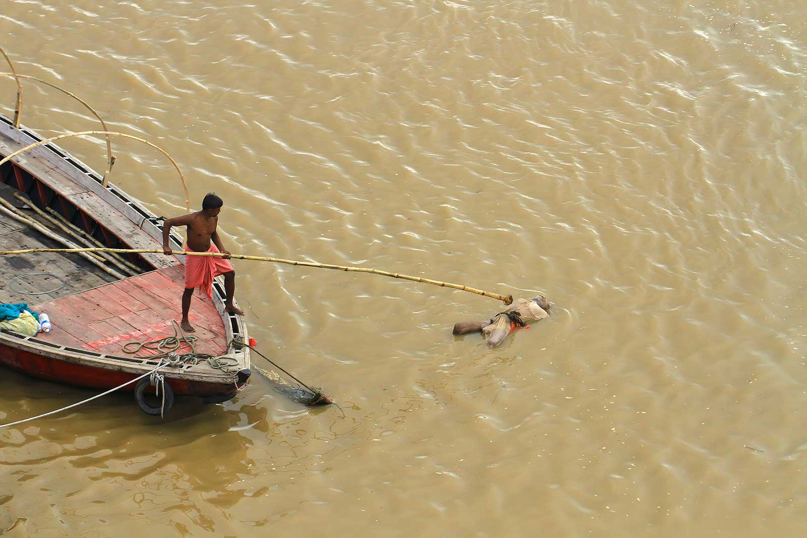 A dead body floating in the Ganges river in Varanasi, India.