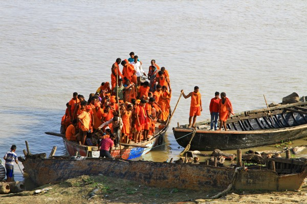 Hindus on a boat rive on the Ganges river in Varanasi, India.