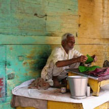 A man selling his goods at a market in Varanasi.