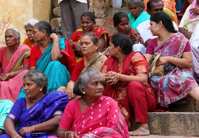 Women sitting on the Ghats in Varanasi.
