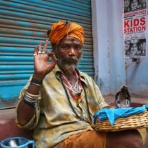 snake-man-varanasi-india