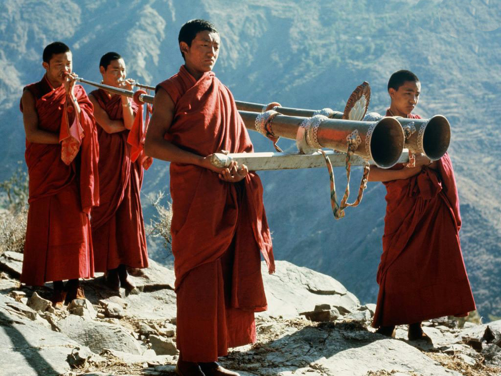 Tibetan monks. Photo credit unknown.