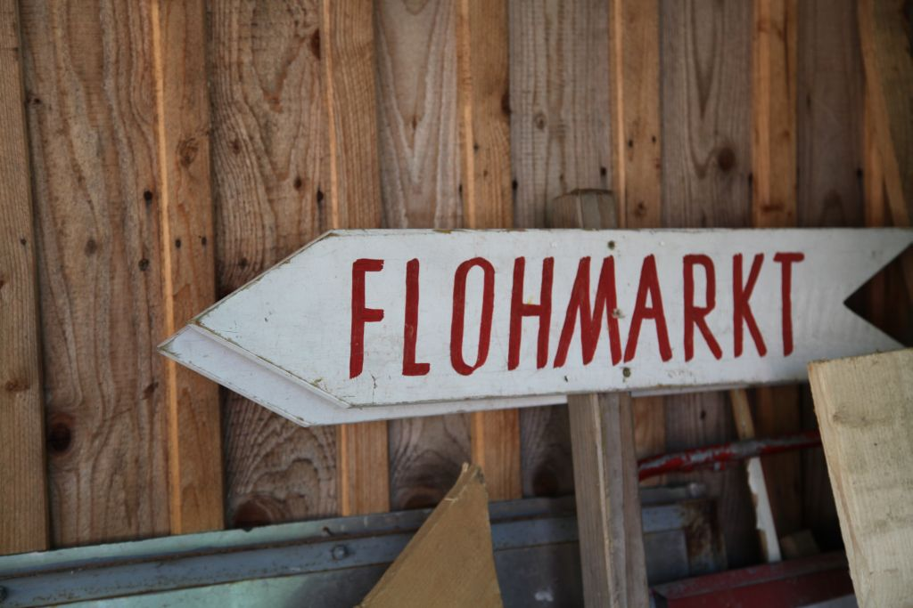 """Flohmarkt"" = Fleamarket in German."
