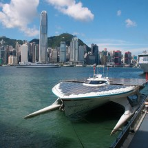 Hong Kong skyline with the ship &quot;PlanetSolar&quot; in Victoria Harbour.