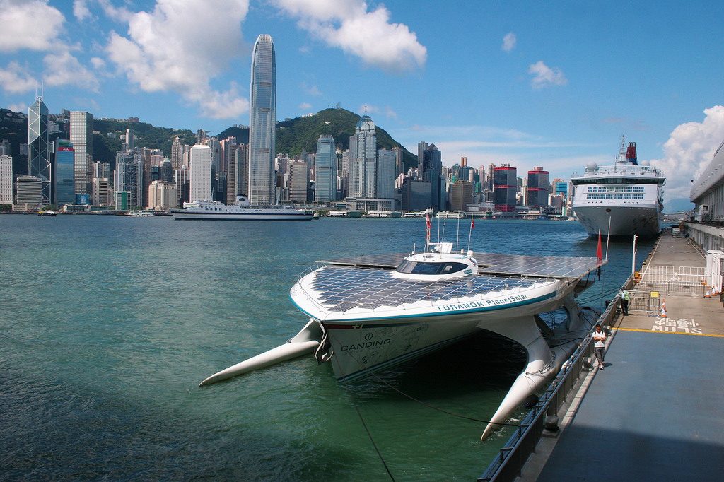 "Hong Kong skyline with the ship ""PlanetSolar"" in Victoria Harbour."