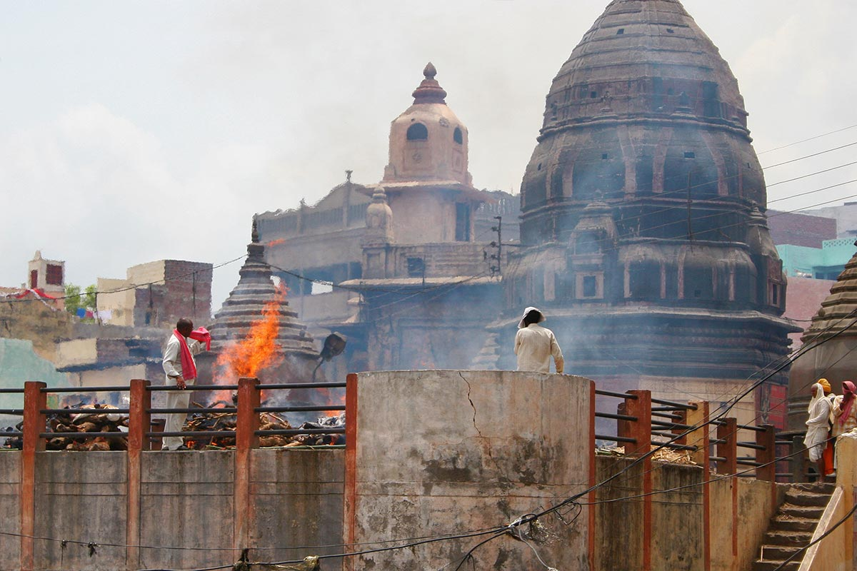 The city of Varanasi has nearly 100 ghats. Most of them are bathing and ceremony ghats, while a few are used exclusively as cremation sites, like the one you can see in the above image.