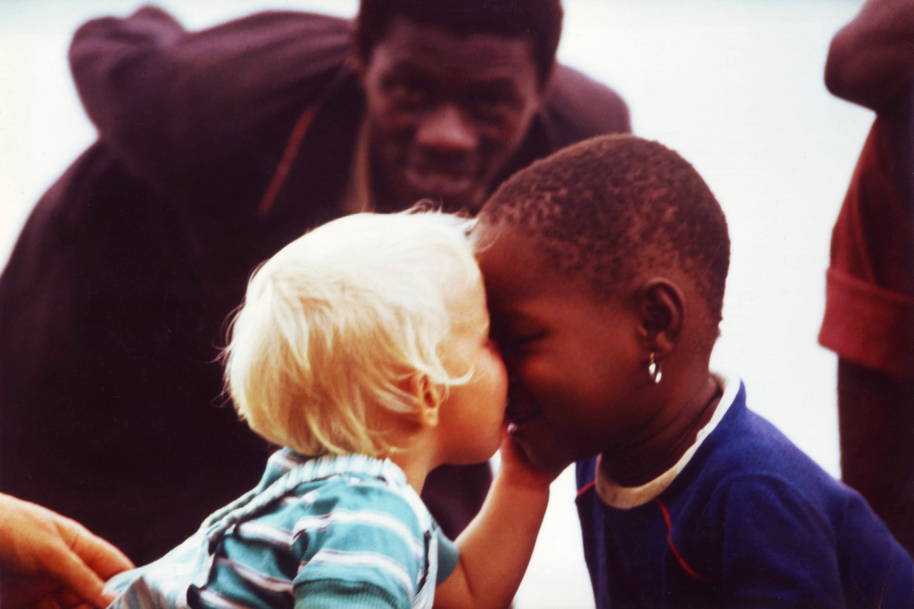 Black & white kids kissing in the Sudan - this is our most viewd picture...
