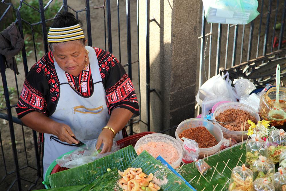 Food vendor at Chatuchak market in Bangkok, Thailand.