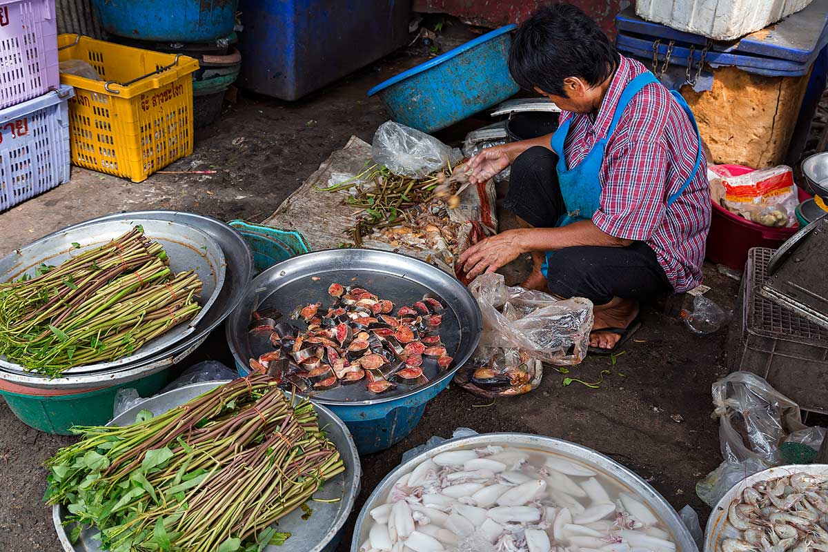 Street vendors can be found all around Khlong Toey fresh market.