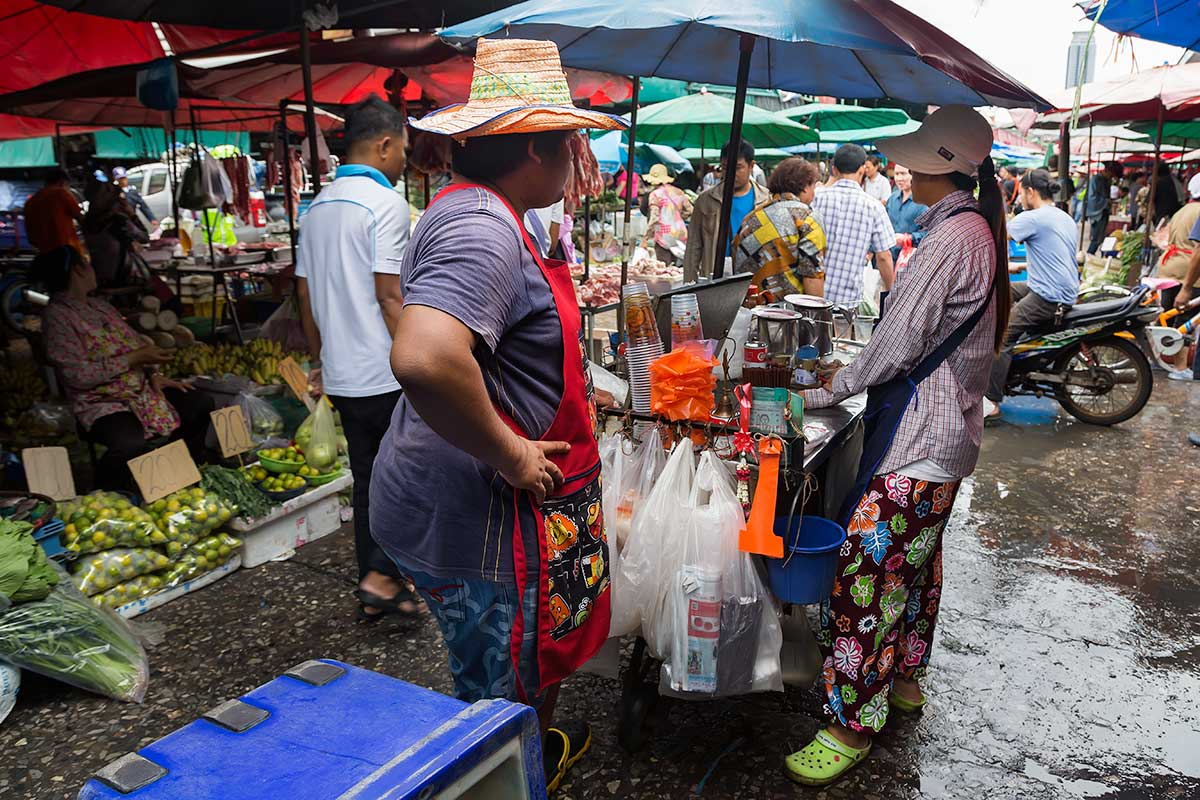 A small, hidden village deep within the Bangkok busy city jungle; Khlong Toey fresh market seems to have a life of its own.