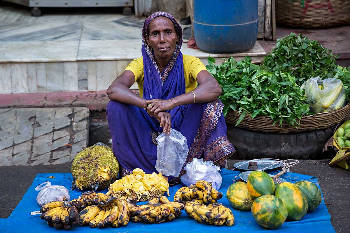 vegetable-market-woman-selling-goods-guwahati-assam-india