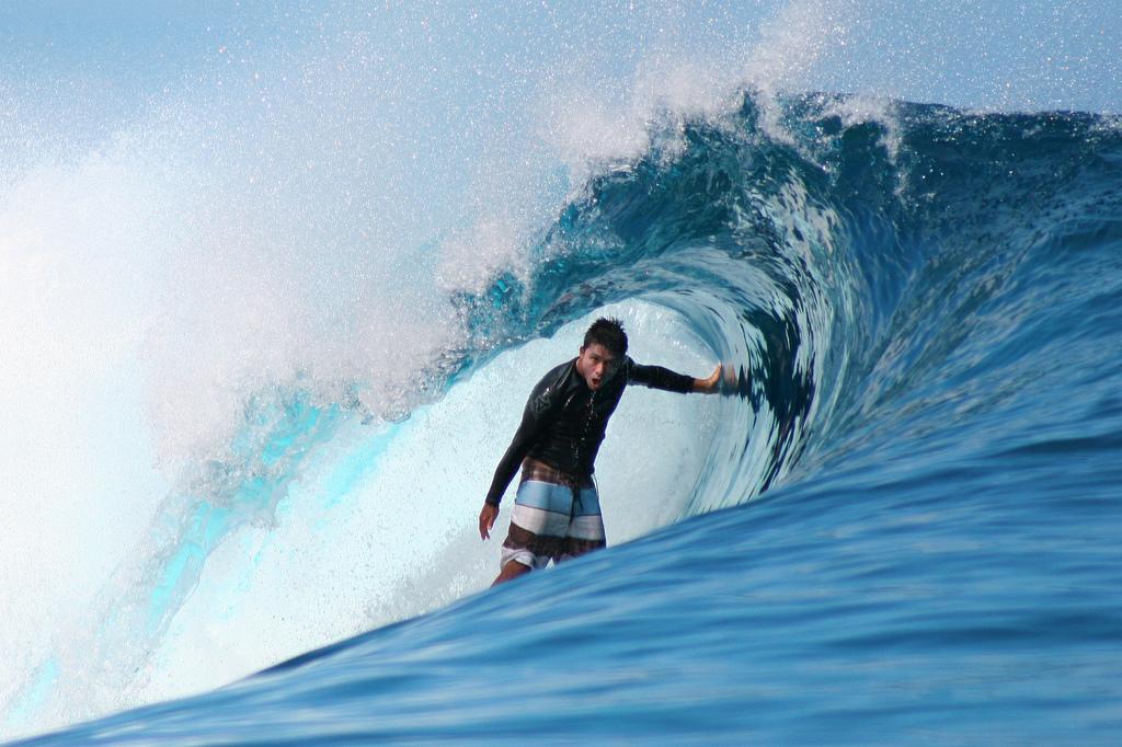 Dennis Tihara surfing at Teahupoo, Tahiti.