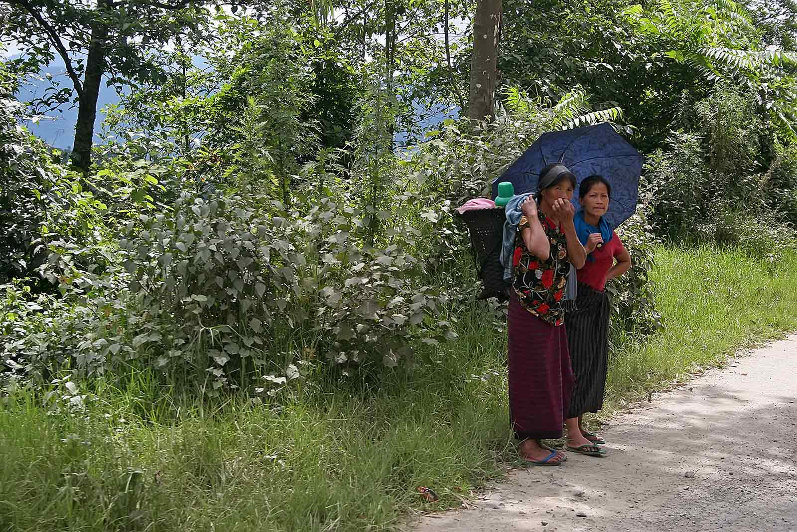 Women waiting for customers on the side of the road.