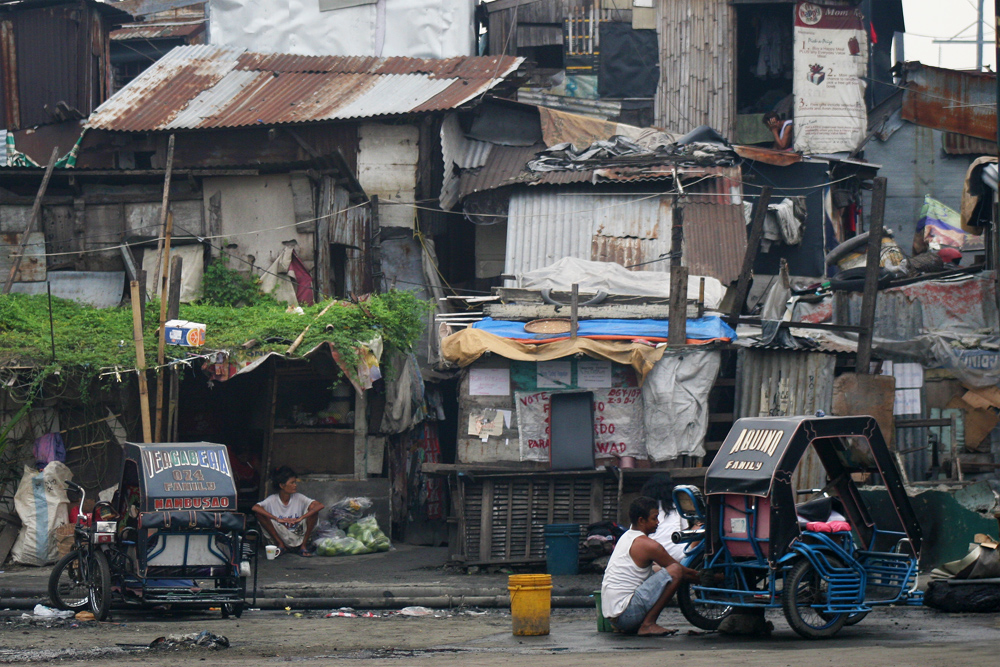"Slum area around ""Smokey Mountain""."