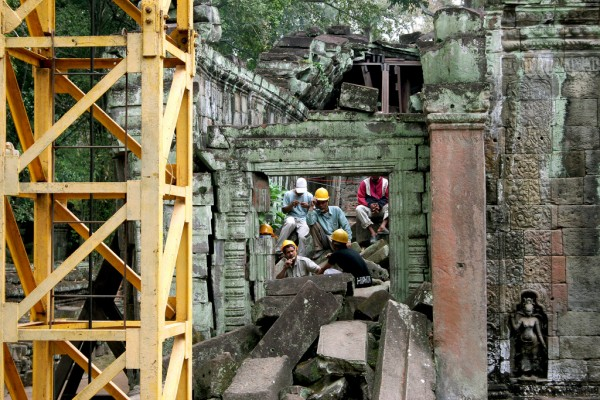 Workers try to keep Angkor Wat in a good stage.