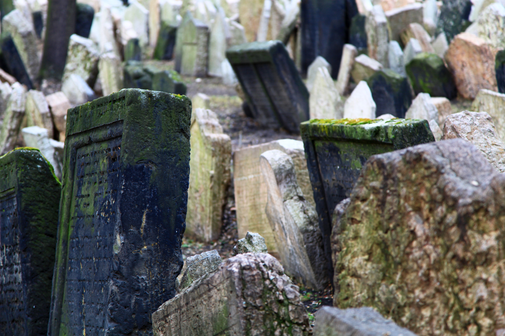 The numbers of grave stones and numbers of people buried at the Old Jewish Cemetery in Prague are uncertain because there are layers of tombs. However, it has been estimated that there are approximately 12,000 tombstones presently visible, and there may be as many as 100.000 burials in all.