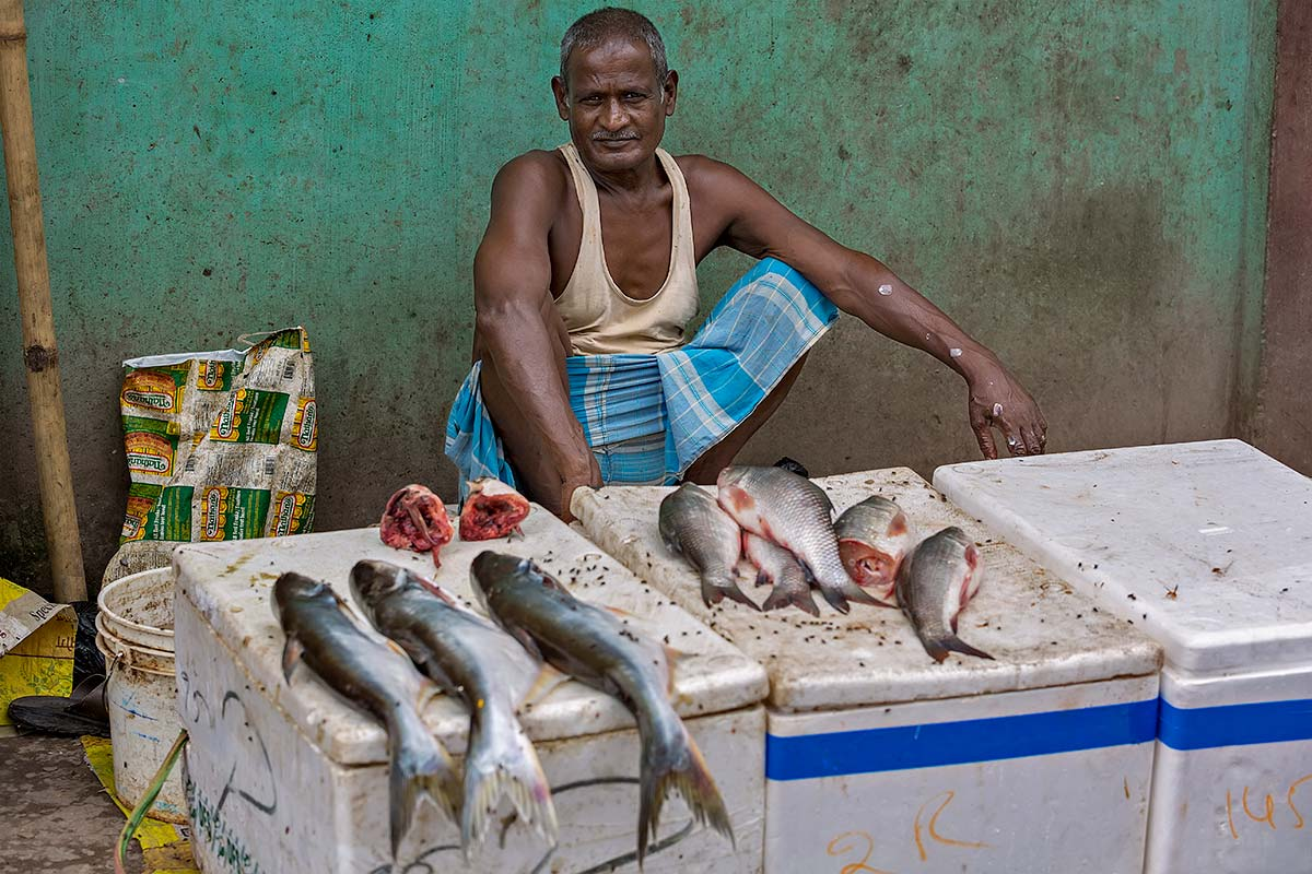 "A local man selling his ""fresh"" fish at the market in Darjeeling."