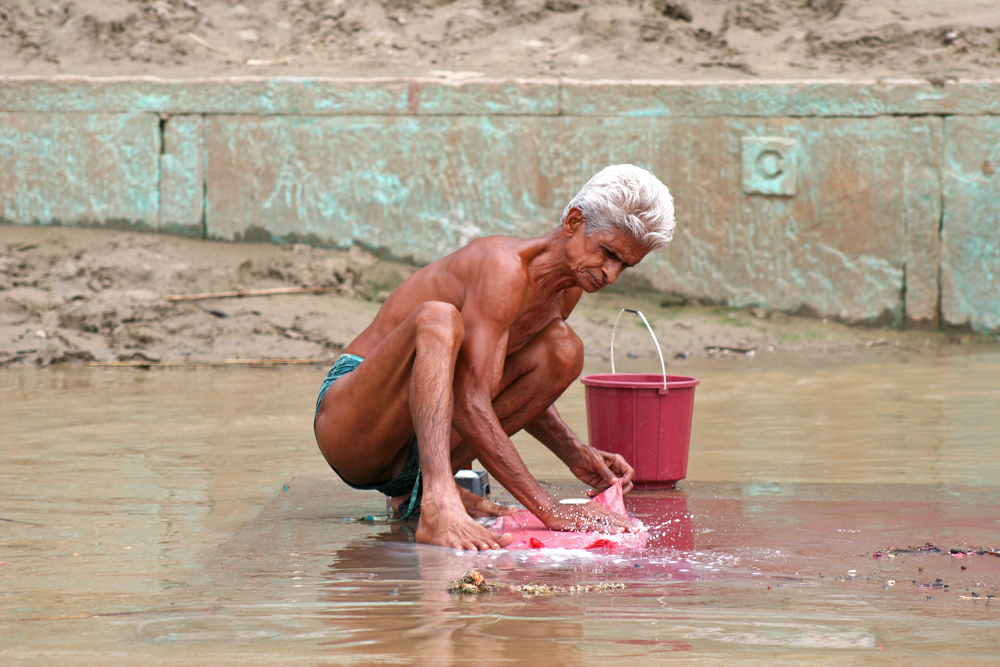 People use the Ganges river for bathing, laundry, washing, eating, cleaning utensils, and brushing teeth.
