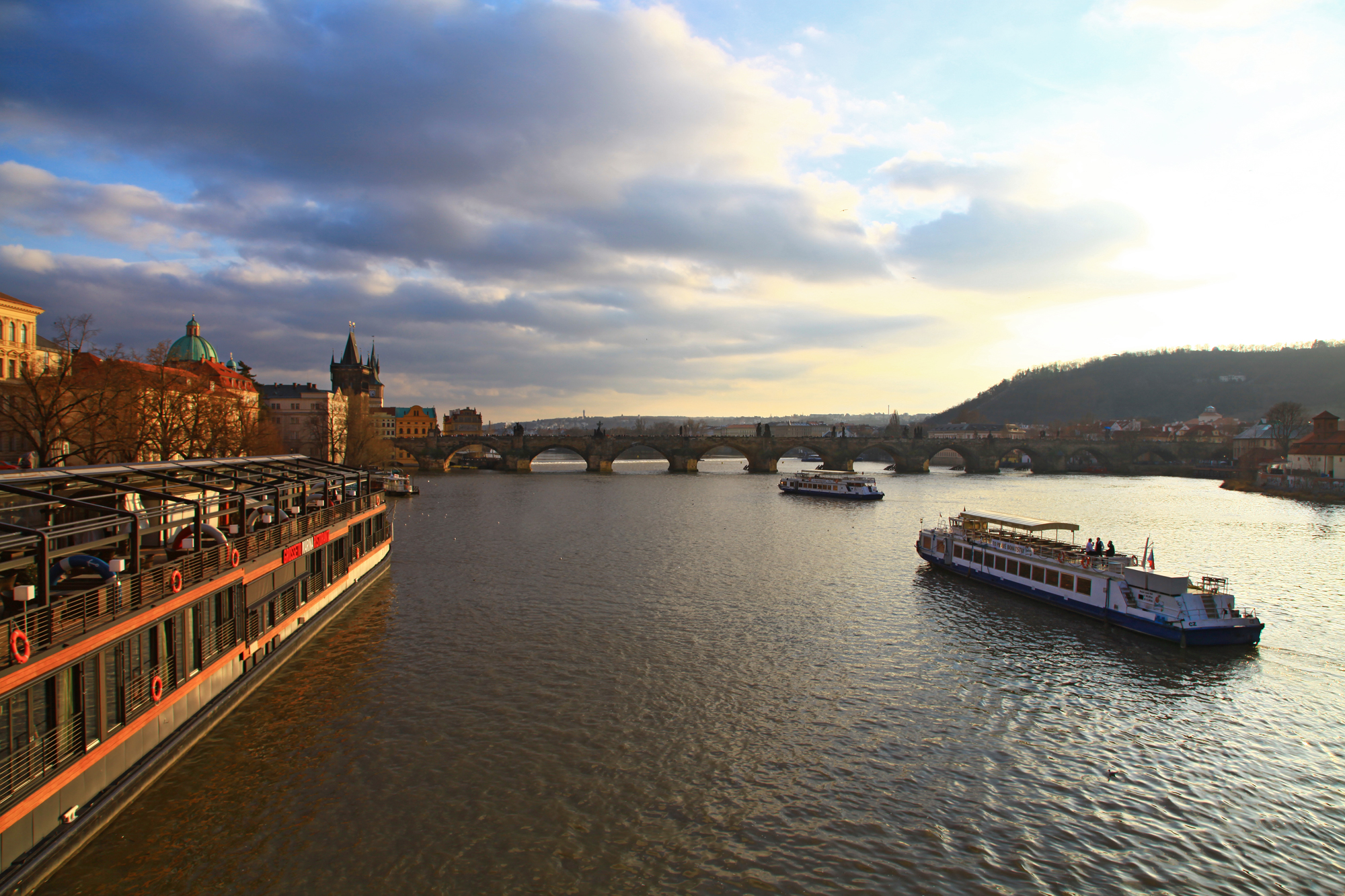 Charles Bridge is a famous historic bridge that crosses the Vltava river in Prague. The construction started in 1357 under the auspices of King Charles IV, and finished in the beginning of the 15th century.