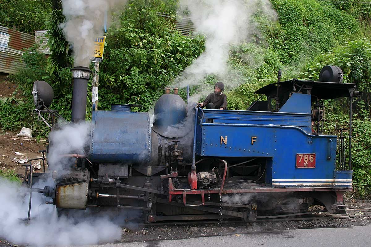 "The Darjeeling Himalayan Railway, also known as the ""Toy Train"", is a 60 cm narrow gauge railway that runs between New Jalpaiguri and Darjeeling."