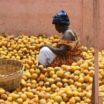 A market woman selling oranges in Accra, Ghana.