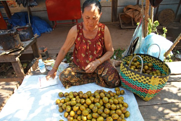 Selling goods at a market in Vientiane.