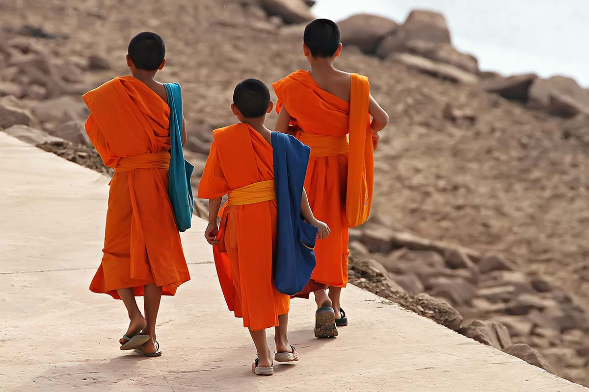 Early in the morning you will see several monks walking along the river bank of the Mekong river.