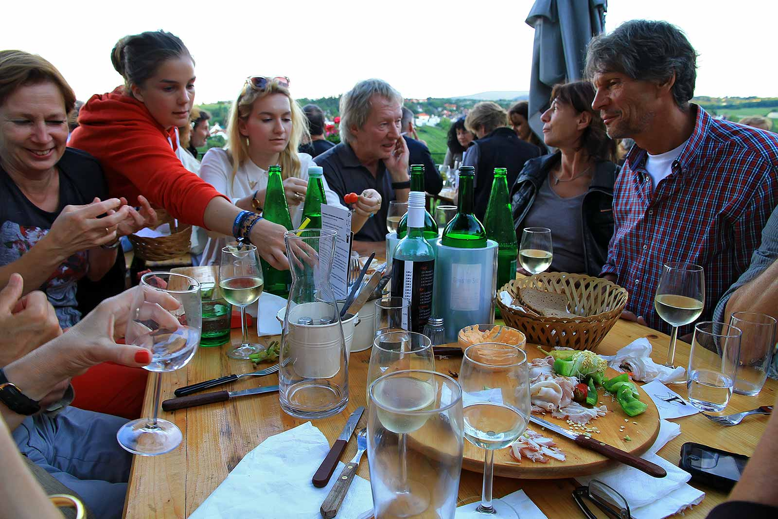 A typical Heurigen get together. The name was given to Eastern-Austrian wine taverns in which wine-growers serve the most recent year's wines.