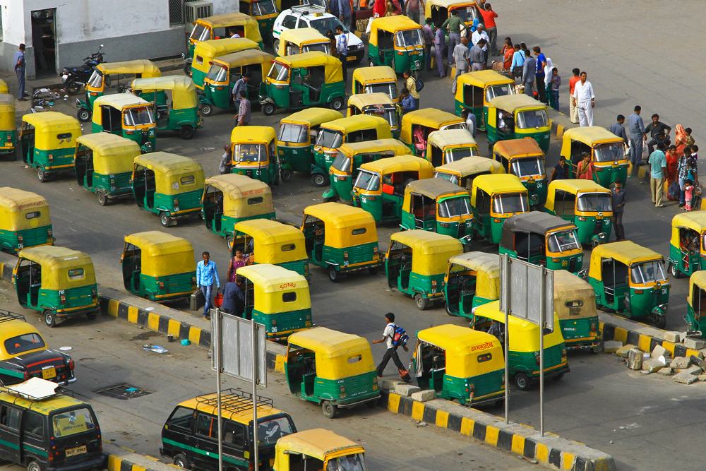 Tuk Tuks waiting for customers at the train station in New Delhi, India.