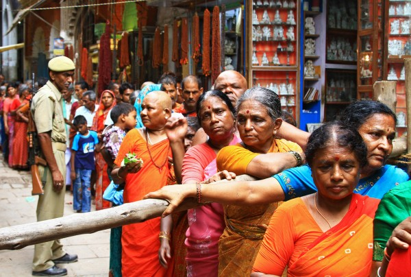 Waiting in line like cattle to enter a holy temple in Varanasi, India.