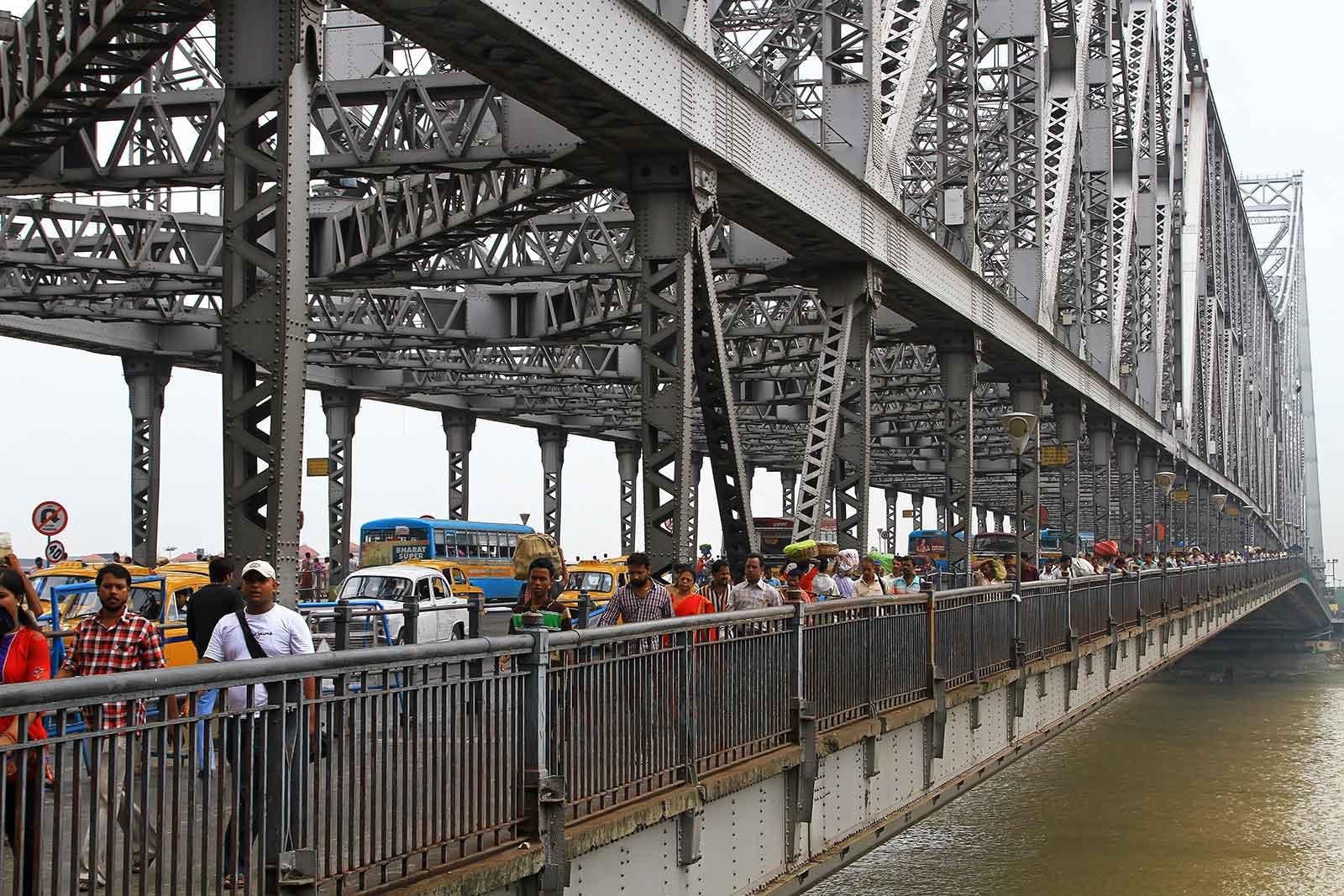 Crossing the Hoogly river on Howrah bridge in Kolkata, India.