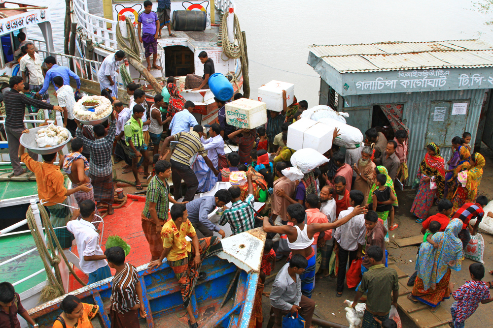 Loading a ferry at Galachipa port in Bangladesh.