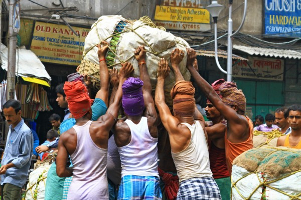 Pure manpower at the wholesale fruit market in Kolkata, India.