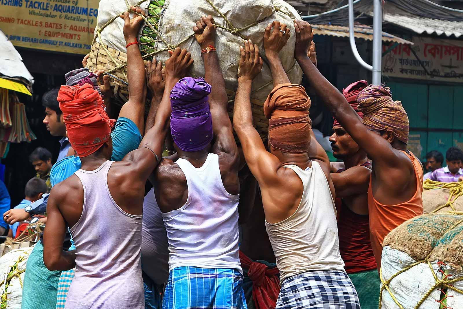 Pure manpower at the wholesale fruit market in Kolkata, India.