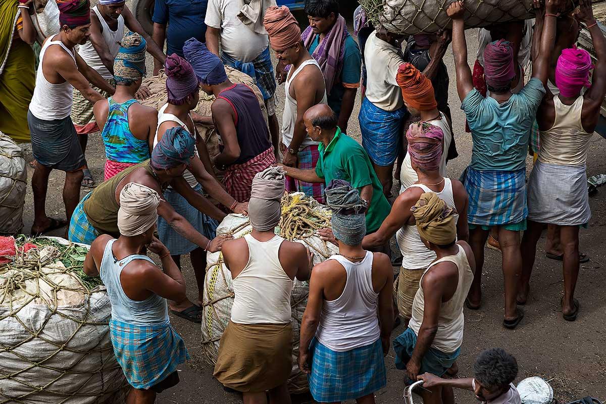 A typical market scene at the wholesale fruit market near the Howrah bridge in Kolkata.