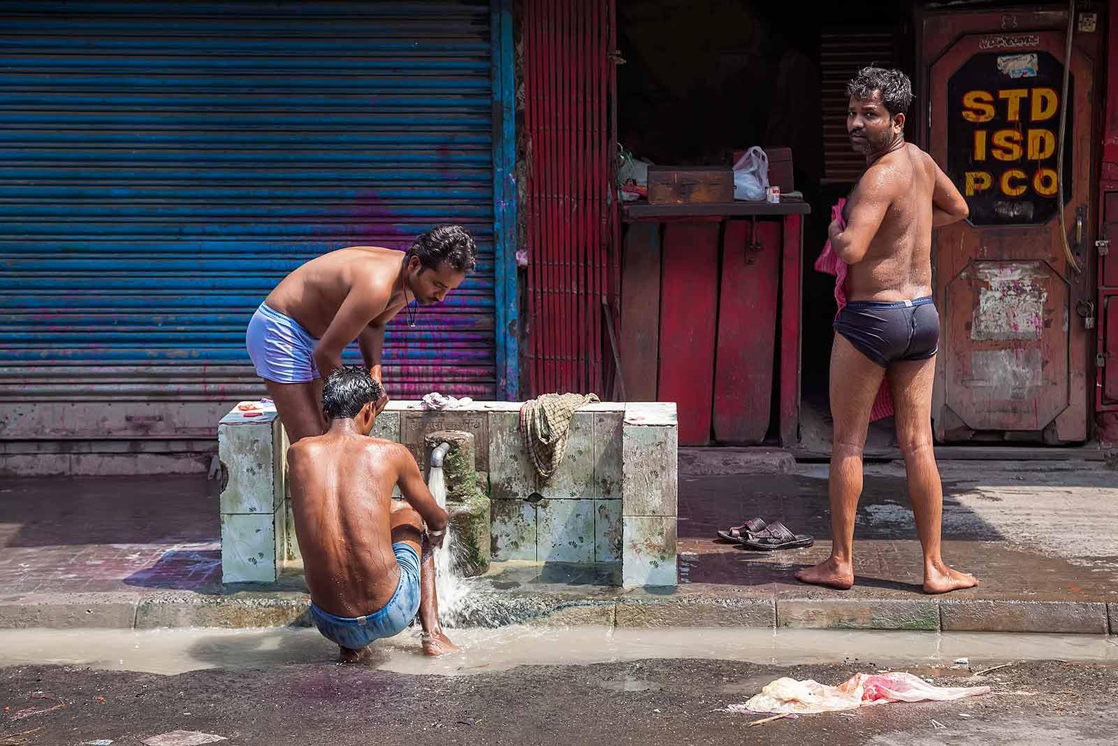 men-washing-streets-kolkata-west-bengal-india