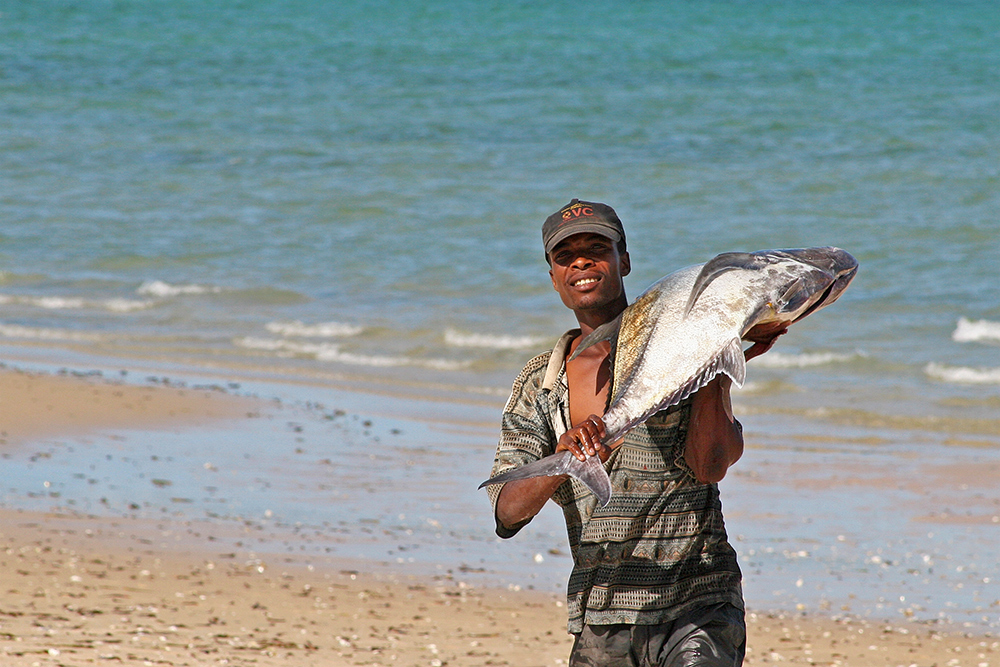 Fisherman on the beach near Bazaruto Island in Mozambique.